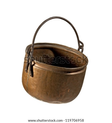An old used copper kettle from the 19th century. - stock photo