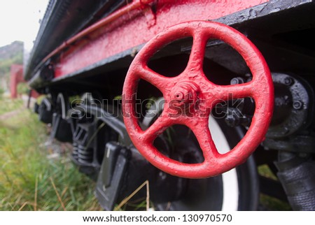 an old valve on an old steam locomotive - stock photo