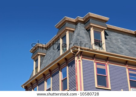 An old Victorian building with a mansard roof.
