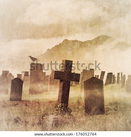 An Old Vintage Grunge Photograph of a Misty Graveyard, Cemetery with Tombstones - stock photo