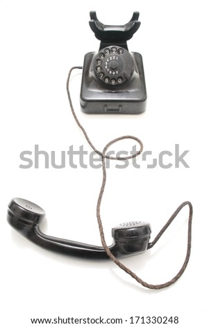 an old vintage telephone in dramatic lighting - stock photo
