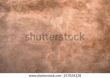 An old wall color sienna, with shades of brown and yellow. - stock photo