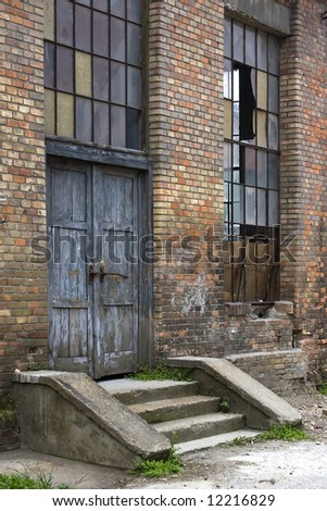 An old warehouse entrance. Red brick and broken windows.