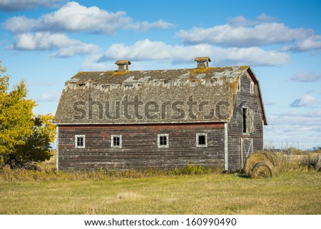 An old weathered vintage barn abandoned on the prairies