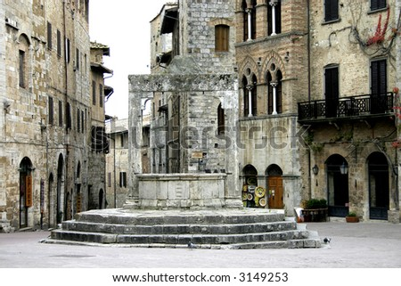 An old well, and meeting place in the old city of San Gimingnano, Tuscany Italy. Nowadays used as a wishing well.