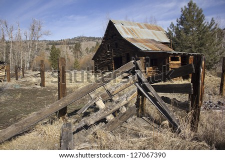 an old western horse stable barn - stock photo