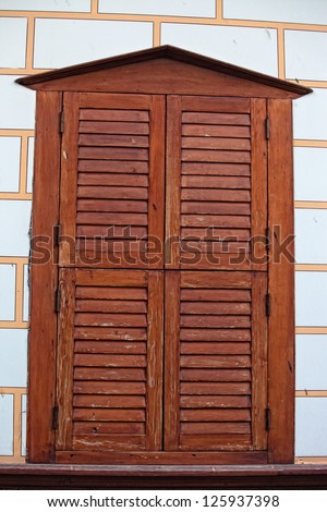 An old window next to a bright wall in old Antalya Turkey - stock photo