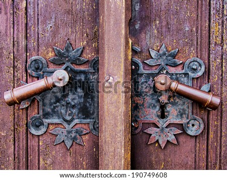 an old wood door with metal handle closeup  - stock photo