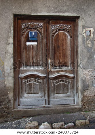 an old wood door with number seven