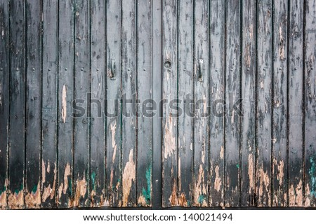 an old wooden and grungy locked door typical of the south of italy - stock photo