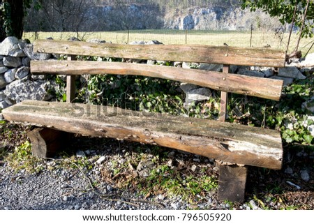 An Old Wooden Bench In Medieval Skocjan Village, Slovenia, Offers A  Marvelous Panoramic View