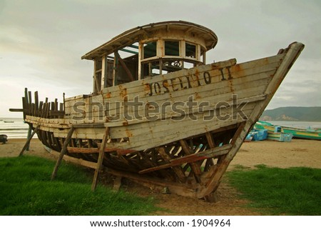 An old wooden boat on a South American Beach.