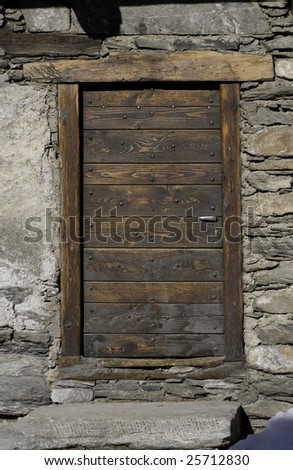 An old wooden door in stone wall