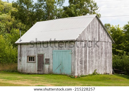 An old wooden shed outside during the day