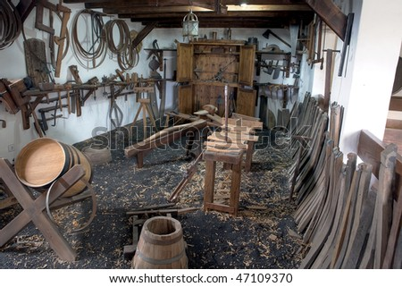 An old workroom with tools and timber - stock photo
