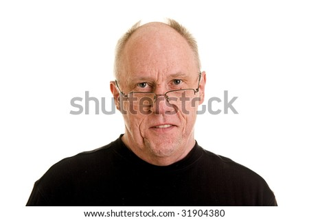 An older bald man in a black shirt looking happy