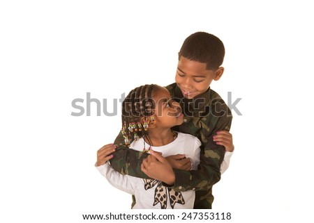 An older brother and younger sister embracing - stock photo