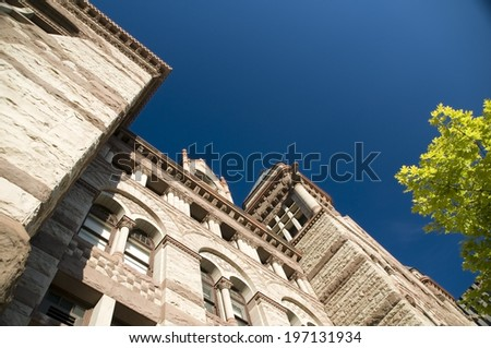 An older building with arch windows and stone walls. - stock photo