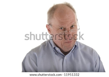 An older guy wearing a blue dress shirt giving a look of skepticism