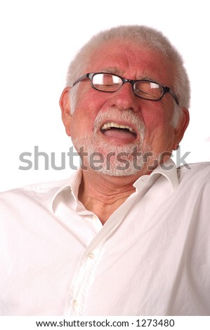 An older man lets out a great laugh - stock photo