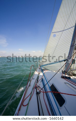 An on board shot sailing on a sunny day