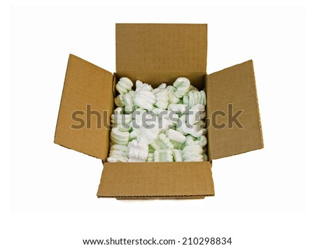 An open box full of packing peanuts, isolated on a white background.Clipping path included.