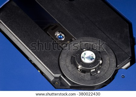 An open CD player showing laser and spindle assemblies - stock photo