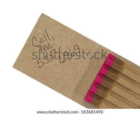 An open matchbook with call me message and generic phone number. - stock photo