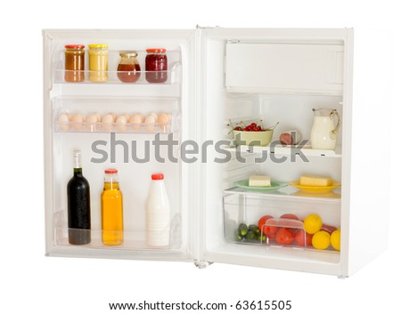 An open refrigerator isolated on white. - stock photo