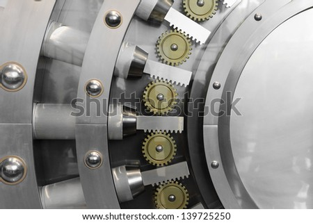 An open safe door in a vault - stock photo