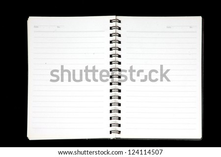 an opened notebook isolated on black background