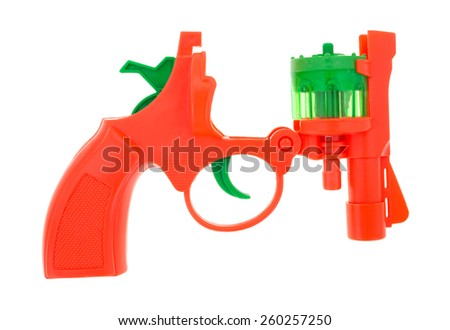 An opened toy cap gun on a white background.