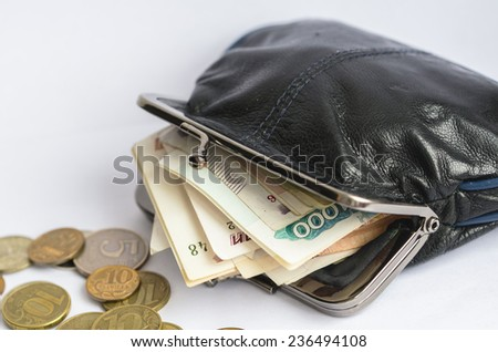 An opened wallet with russian ruble banknotes inside - stock photo