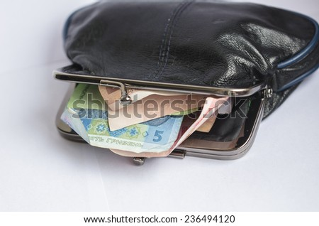 An opened wallet with ukrainian hryvnia banknotes inside