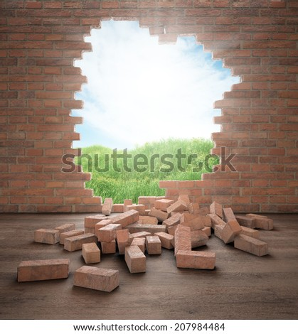 An opening in a brick wall - stock photo