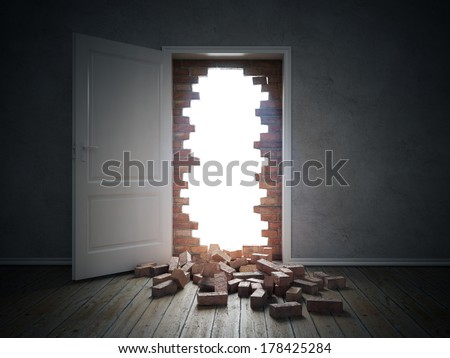 An opening in a brick wall blocking the doorway - stock photo