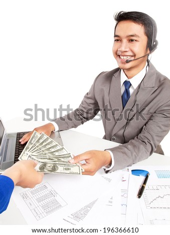 an operator receives a lot of money dollars, isolated on white background - stock photo