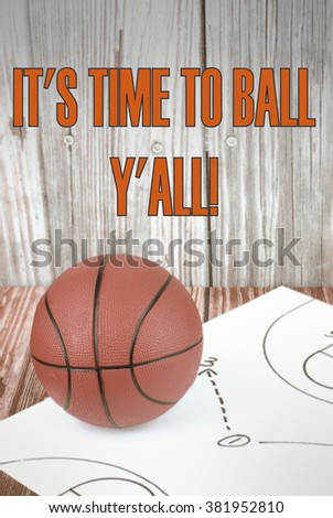 An orange basketball on a wood floor in front of a wood wall with set plans is a great image for basketball. Set plans are black on white. Text added. Vintage filter applied to vertical image. - stock photo