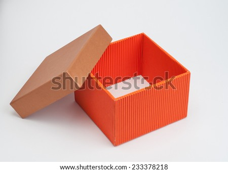 An orange color opened gift box on white background. - stock photo
