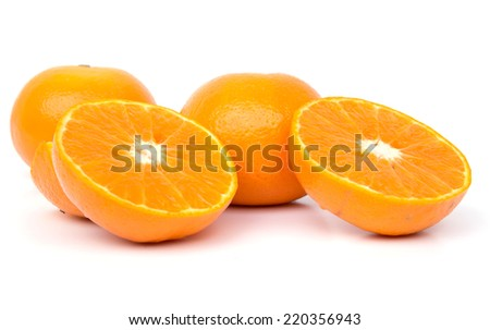 An orange cut in half and three whole oranges.