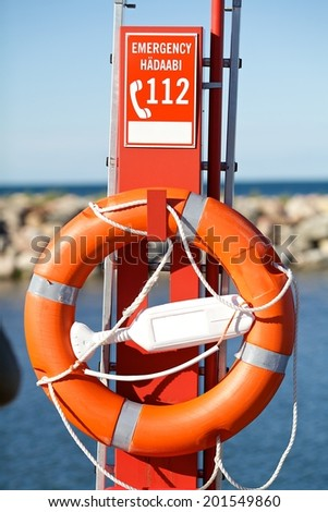 An orange lifesaver on the deck of a cruise ship - stock photo