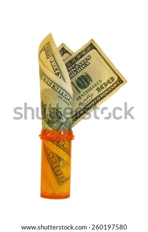 An orange prescription bottle with a few hundred dollars rolled and sticking out of the top of the bottle isolated on a white background - stock photo