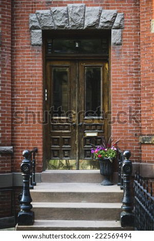 an ornate door in a big city - stock photo
