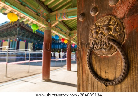 An ornate door knocker at Bulguksa Temple in Gyeongju, South Korea. - stock photo