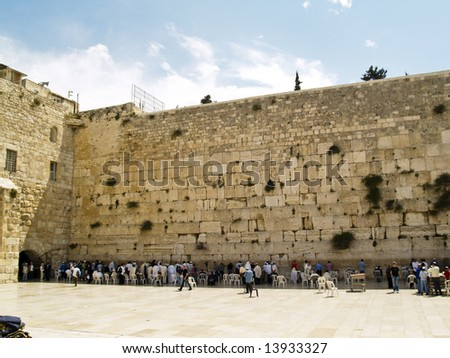 An orthodox people praying at the wailing wall - stock photo