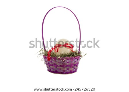 An ostrich egg ina basket is decorated with a red ribbon - stock photo