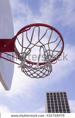 An outdoor basketball court in Chicago as a blue sky paints the background.