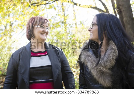 An Outdoor portrait of caucasian senior mother with her adult daughter