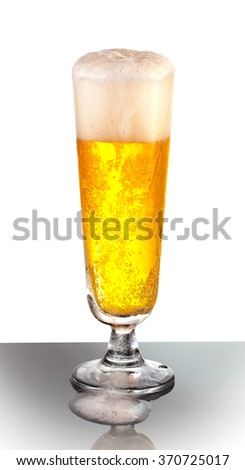 An overflowing glass of refreshing pilsner beer