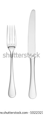 an overhead shot of a chrome silver knife and fork isolated on white with paths - stock photo